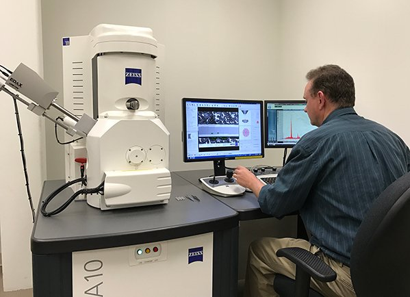 AMETEK Coining technician uses a Zeiss scanning electron microscope with AMETEK EDAX silicon drift detector to perform laboratory analysis.